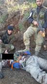 Umírněná opozice nad tělem pilota sestřeleného Su 24 podplukovníkem Olegem Peškovem. To jsou ti chlapci, s nimiž má být vytvořena nová